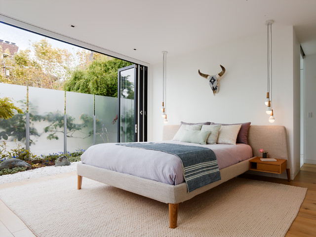 Bedroom - mid-sized contemporary master light wood floor bedroom idea in San Francisco with white walls
