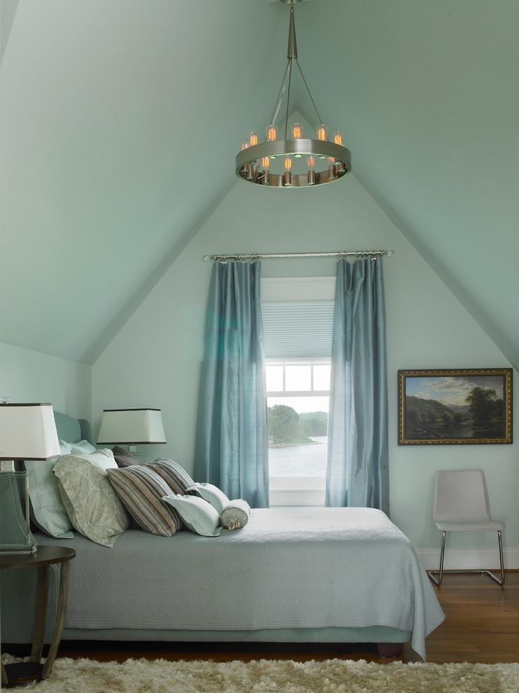 Elegant medium tone wood floor bedroom photo in Baltimore with blue walls