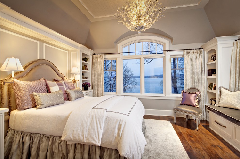 Inspiration for a large timeless master medium tone wood floor bedroom remodel in Milwaukee with beige walls and no fireplace