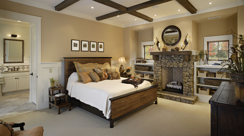 Mountain style bedroom photo in Other with a stone fireplace and a standard fireplace