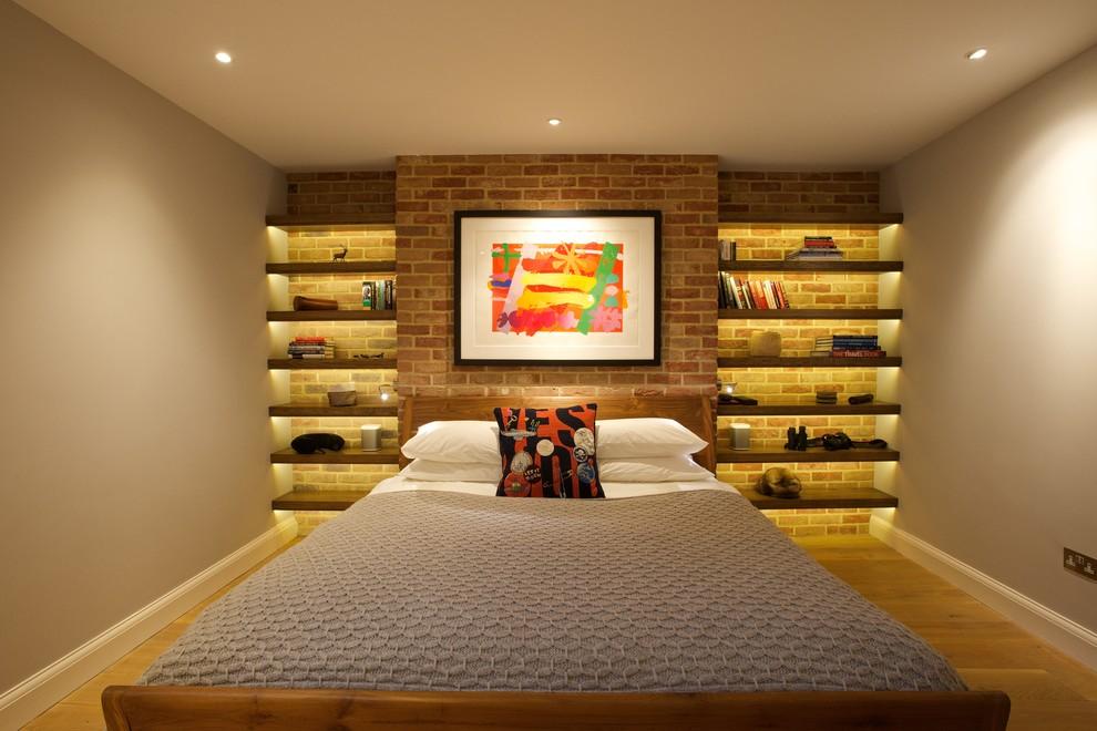 Mid-sized trendy medium tone wood floor and brown floor bedroom photo in London with gray walls