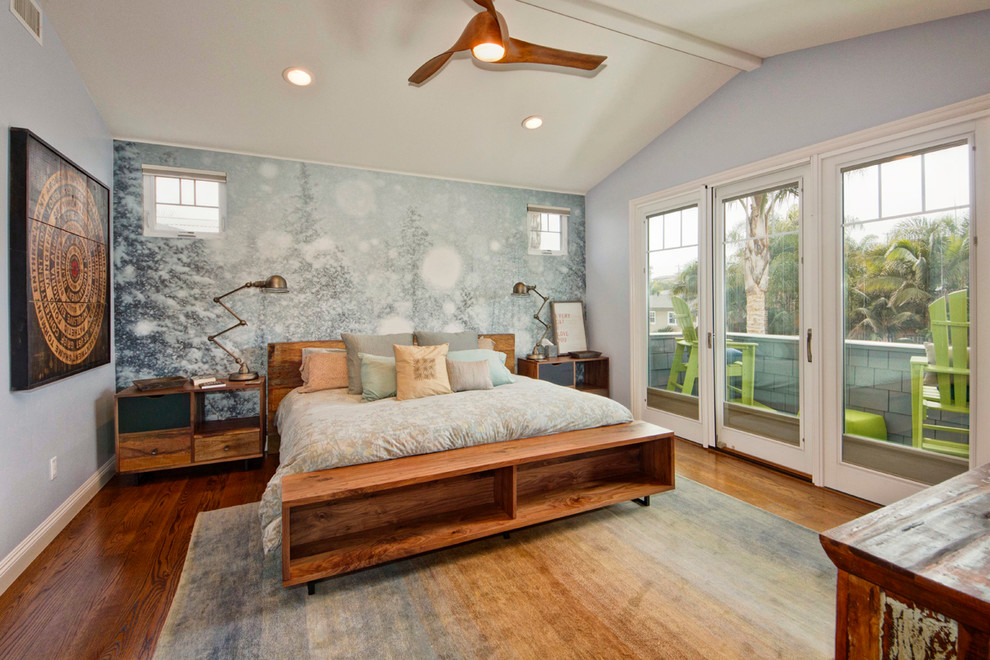 Inspiration for a contemporary medium tone wood floor bedroom remodel in San Diego with gray walls
