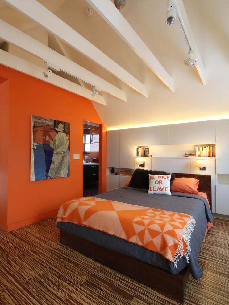 Mid-sized trendy dark wood floor bedroom photo in Boston with orange walls