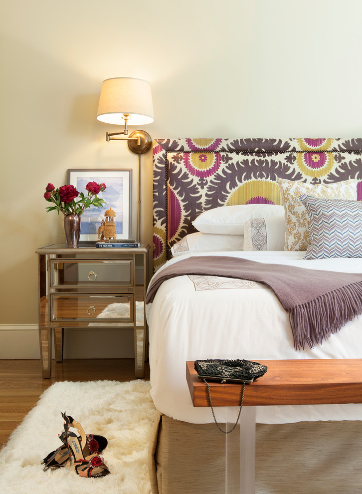 Example of a trendy medium tone wood floor bedroom design in Boston with beige walls