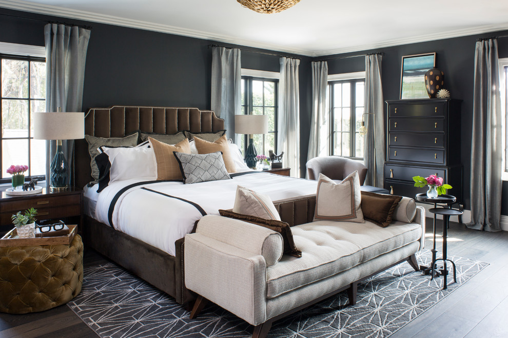 Huge transitional master dark wood floor and brown floor bedroom photo in Los Angeles with black walls and no fireplace