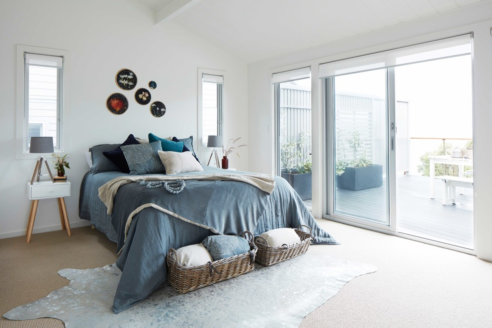 Example of a danish master carpeted bedroom design in Central Coast with white walls
