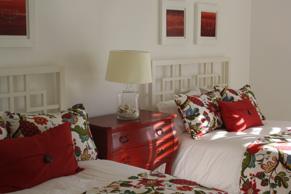 Example of an island style guest bedroom design in Other