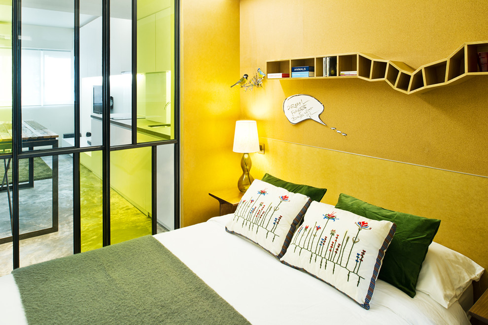 Example of an urban bedroom design in Hong Kong with yellow walls