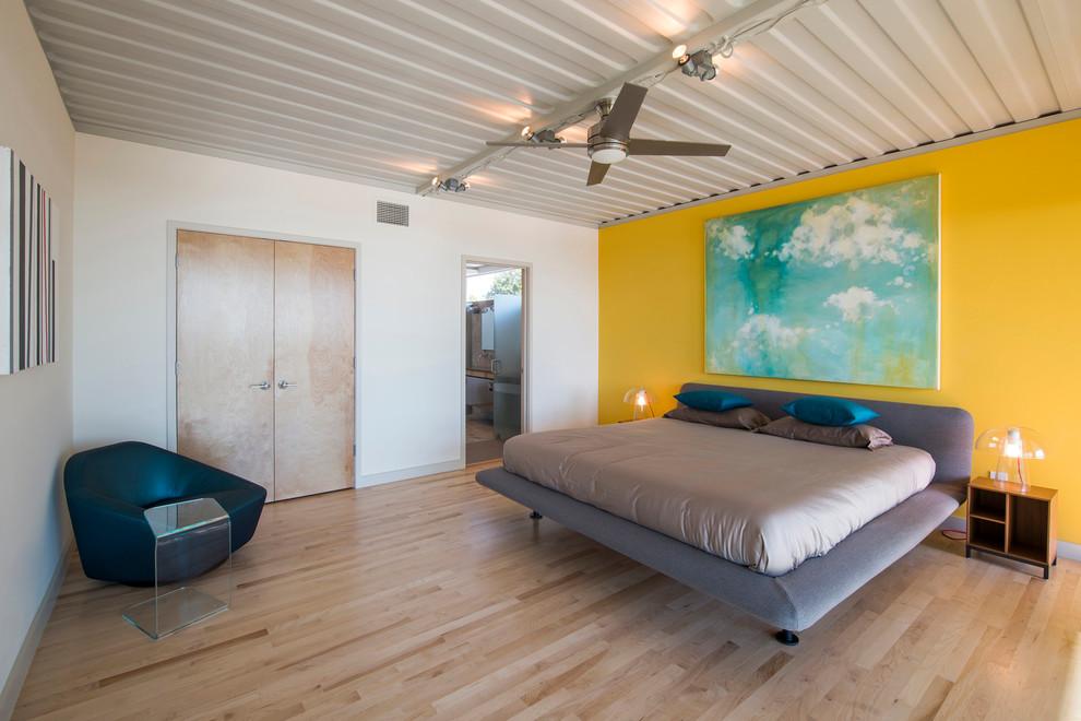 Trendy light wood floor bedroom photo in Dallas with yellow walls