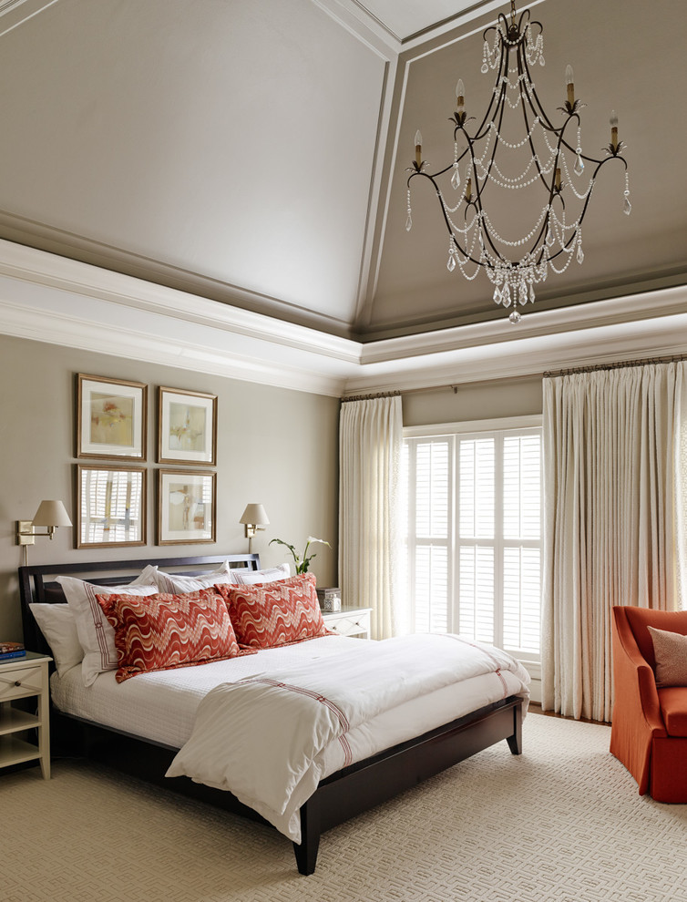 Elegant bedroom photo in Charlotte with gray walls