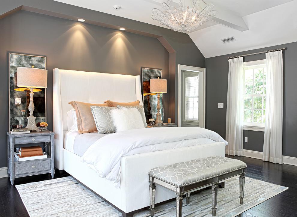Example of a classic dark wood floor bedroom design in New York with gray walls