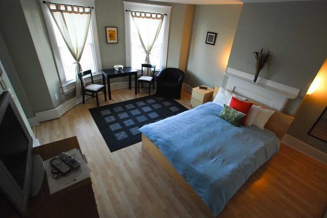 RE design of CAJ House eclectic-bedroom