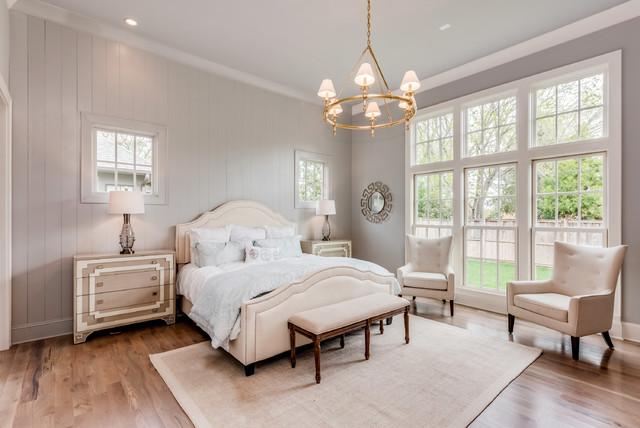 Bedroom - country master light wood floor and beige floor bedroom idea in Other with gray walls