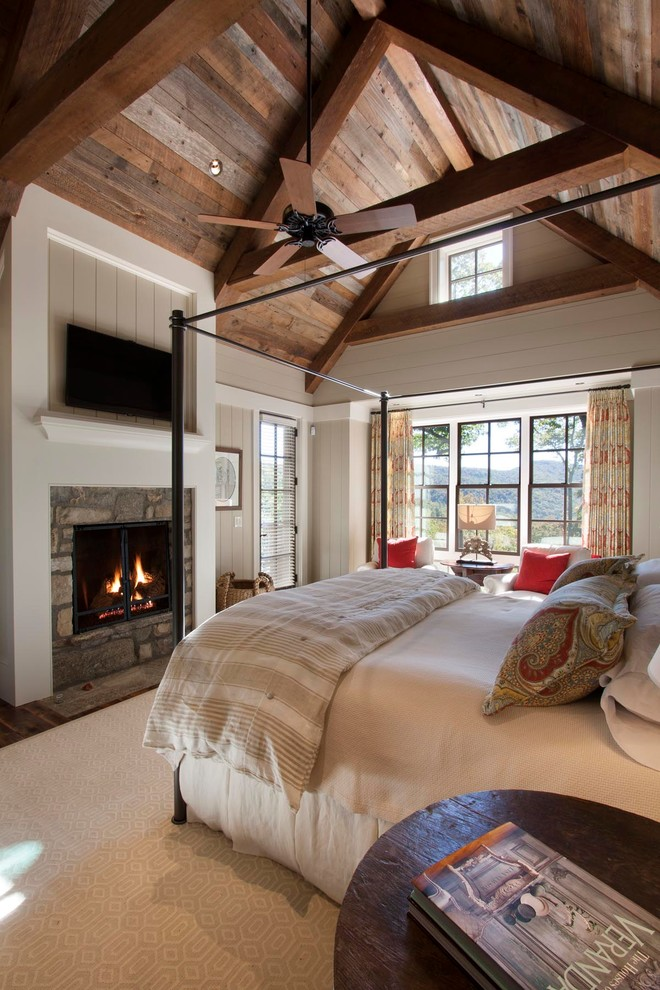 Bedroom - rustic bedroom idea in Other with a standard fireplace and a stone fireplace