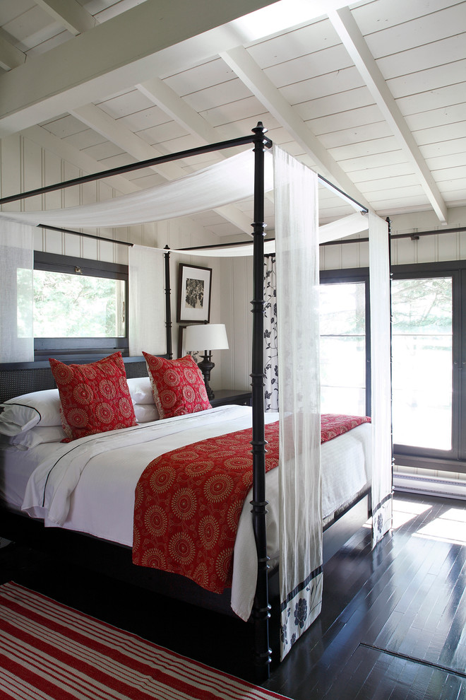 Inspiration for a coastal bedroom remodel in Other with white walls