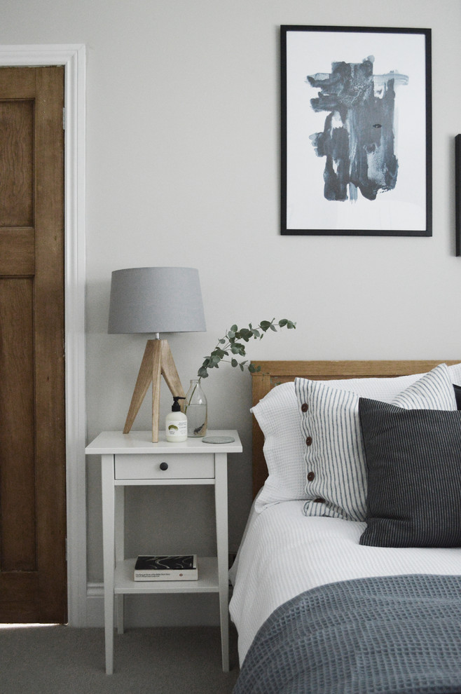 Small danish guest carpeted and gray floor bedroom photo in Other with gray walls