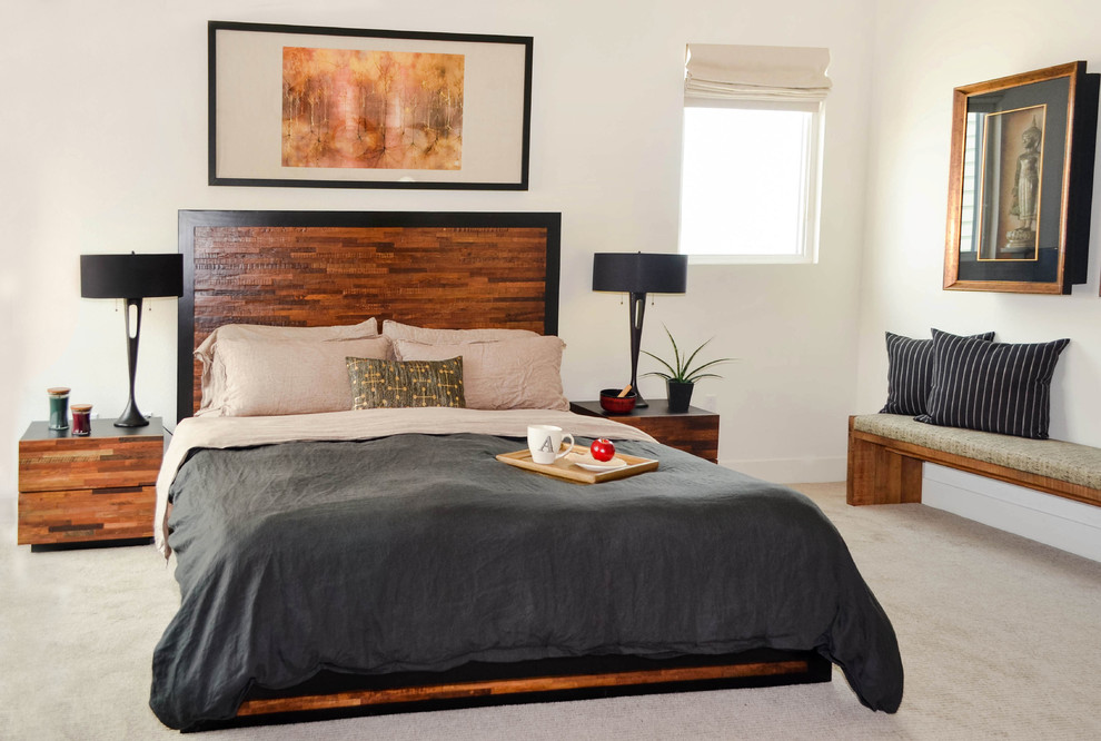 Example of a huge asian master carpeted and beige floor bedroom design in Los Angeles with white walls and no fireplace