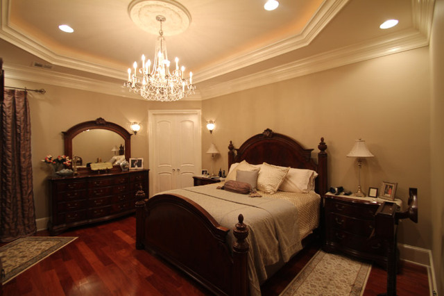 example of a large classic master medium tone wood floor bedroom design in new orleans