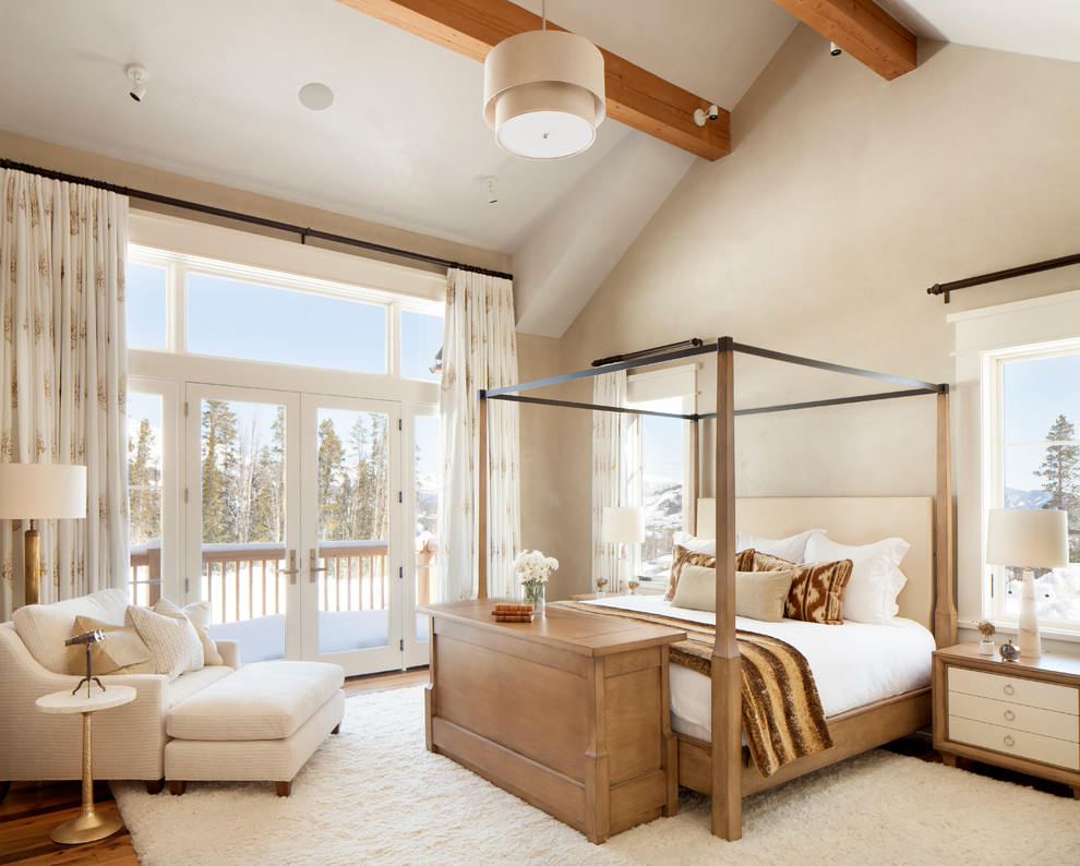 Inspiration for a mid-sized transitional master medium tone wood floor bedroom remodel in Salt Lake City with beige walls