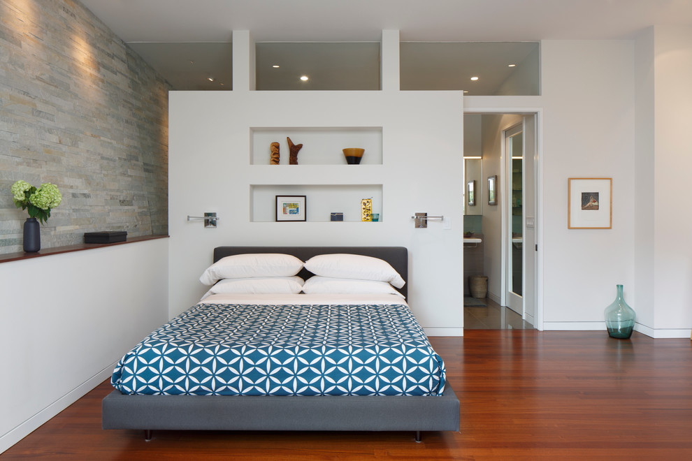 Example of a 1960s master medium tone wood floor bedroom design in San Francisco with white walls