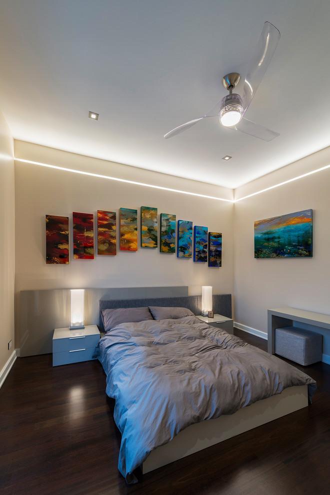 Example of a trendy dark wood floor bedroom design in Chicago with beige walls