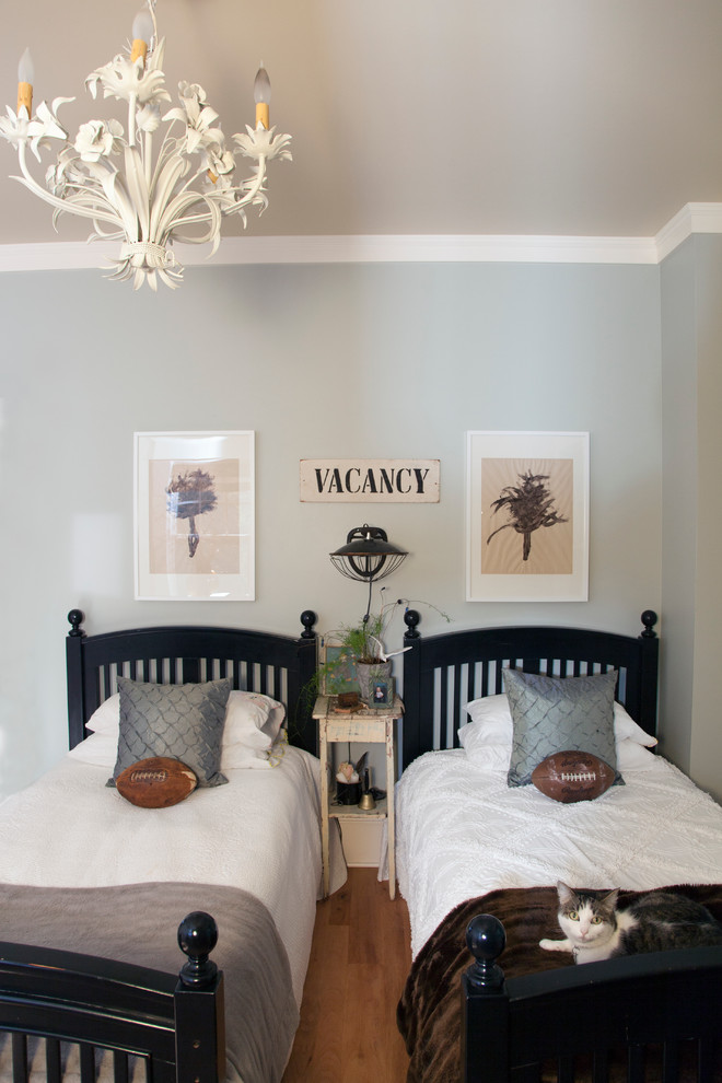 Eclectic bedroom photo in Portland with blue walls