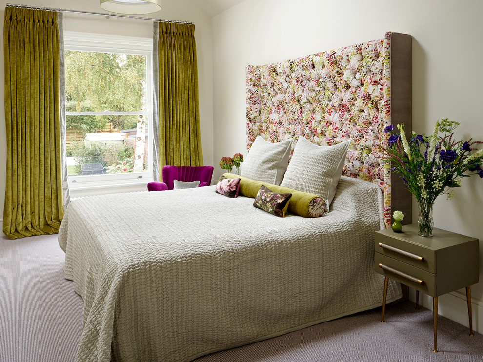 Large transitional master carpeted bedroom photo in London with beige walls