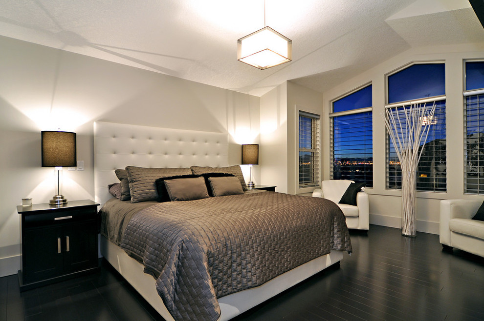 Inspiration for a contemporary black floor bedroom remodel in Calgary with white walls