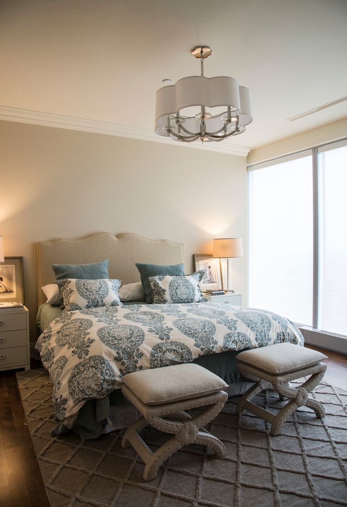 Large transitional master medium tone wood floor and brown floor bedroom photo in Toronto with beige walls and no fireplace
