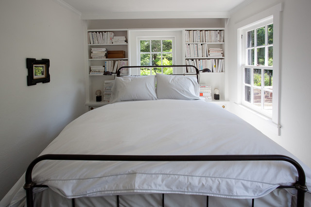 inspiration for a farmhouse bedroom remodel in philadelphia with white walls