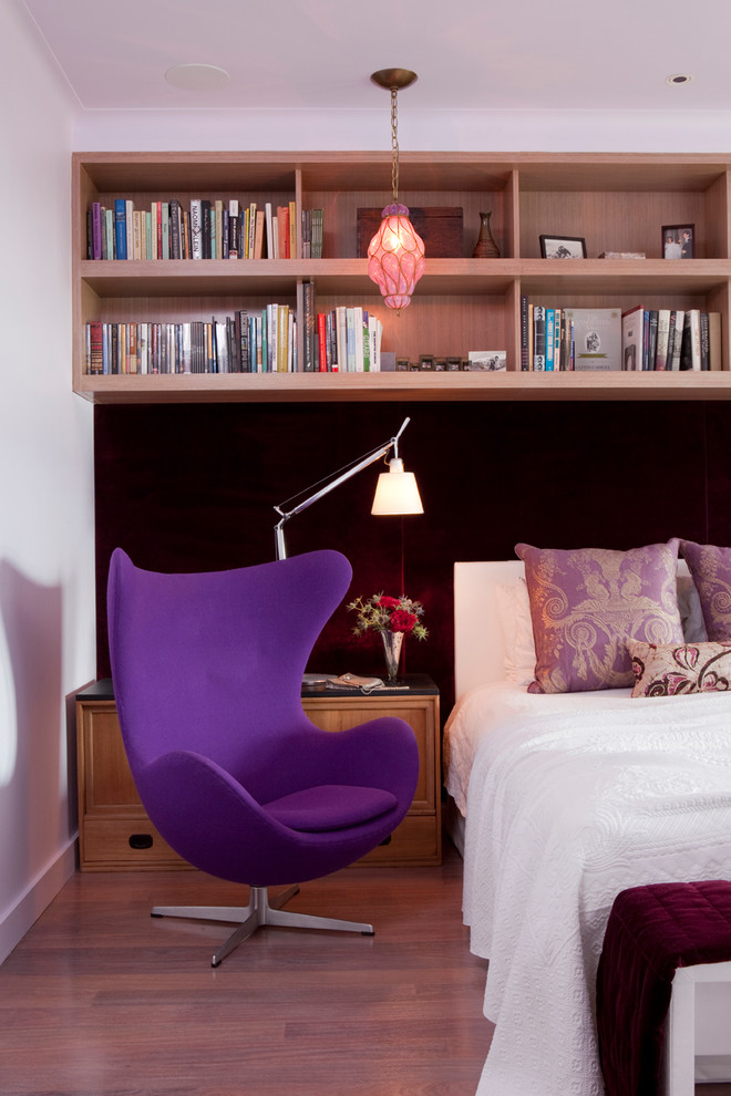 Example of a trendy light wood floor bedroom design in New York with white walls
