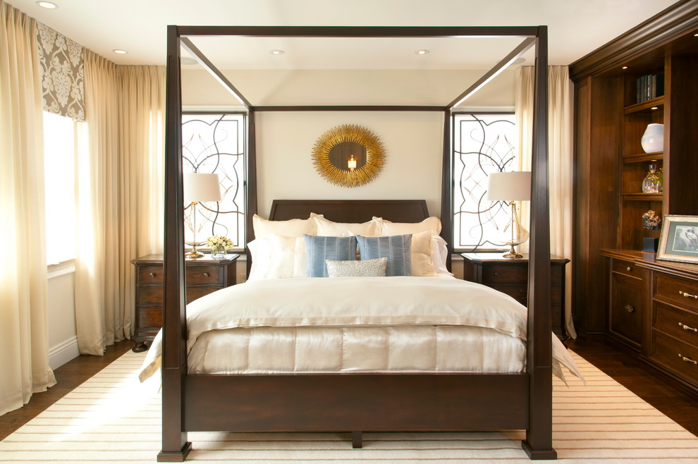 Inspiration for a large timeless master dark wood floor bedroom remodel in San Diego with beige walls