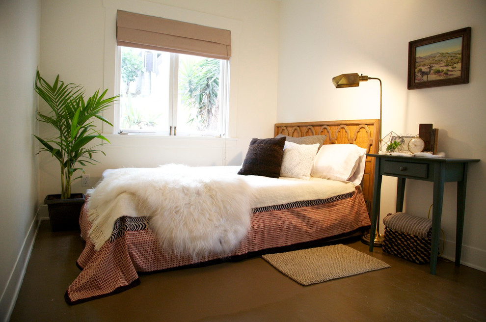 Inspiration for a mid-sized 1960s master dark wood floor and black floor bedroom remodel in Los Angeles with white walls and no fireplace