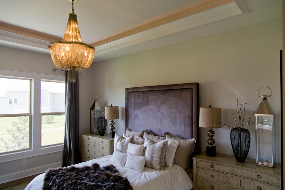 Large minimalist master medium tone wood floor and brown floor bedroom photo in Kansas City with gray walls
