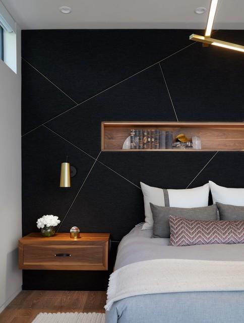 Trendy master dark wood floor bedroom photo in Austin with black walls