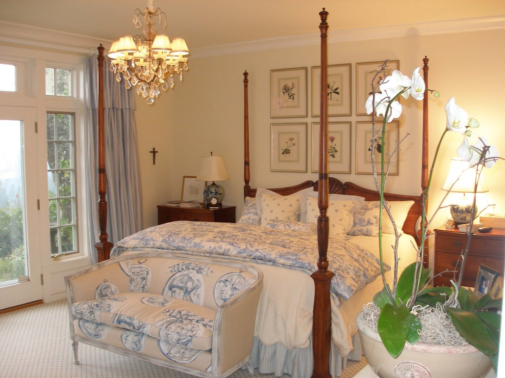 Example of a classic carpeted bedroom design in Portland with beige walls