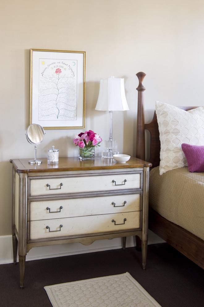 Example of a classic dark wood floor bedroom design in Boston with beige walls