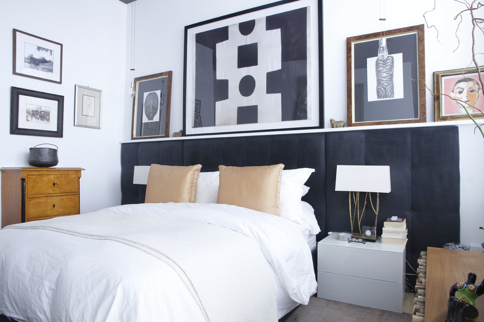 Inspiration for an eclectic bedroom remodel in Montreal with white walls