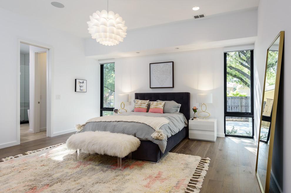 Trendy master dark wood floor and brown floor bedroom photo in Dallas with white walls