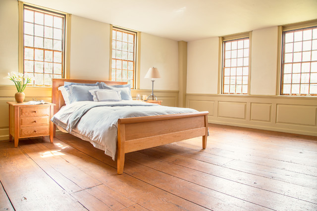 Example of a mid-sized classic master bedroom design in Burlington with white walls