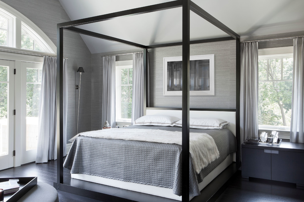 Example of a transitional dark wood floor bedroom design in New York with gray walls