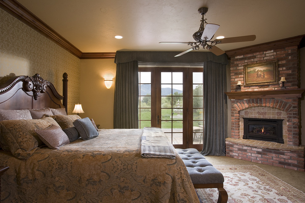 Example of a mountain style bedroom design in Other with a brick fireplace and a corner fireplace