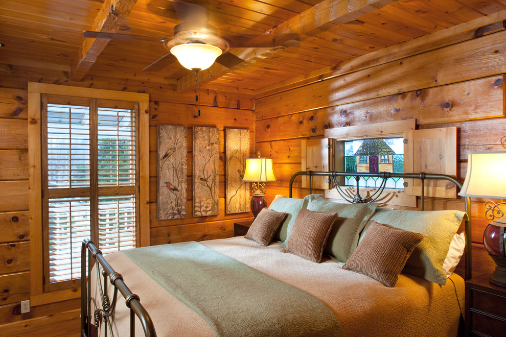 Mountain style medium tone wood floor bedroom photo in Other