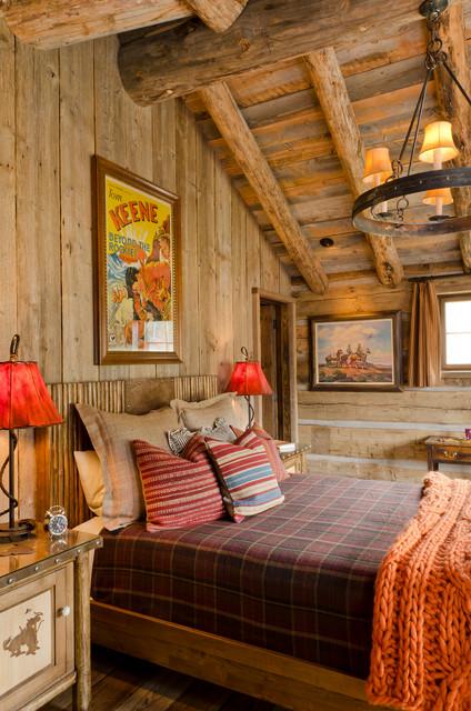 Bedroom - rustic medium tone wood floor bedroom idea in Other