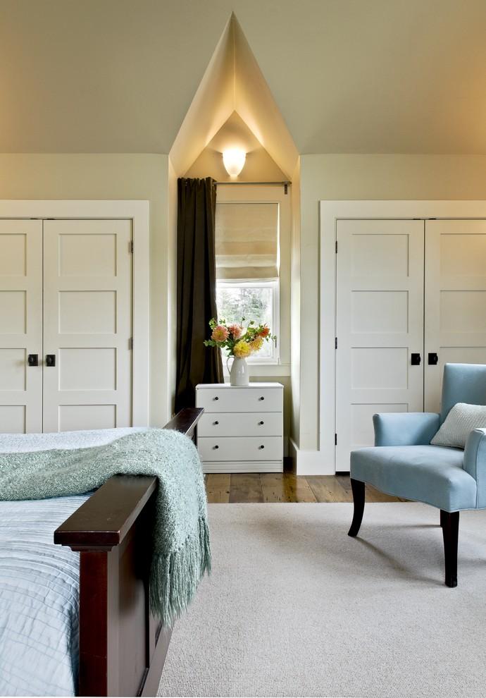 Example of a mountain style medium tone wood floor bedroom design in Burlington with beige walls