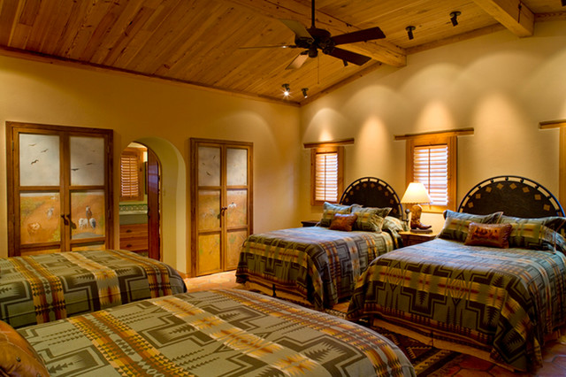 Rustic Hacienda Style Texas Ranch mediterranean-bedroom