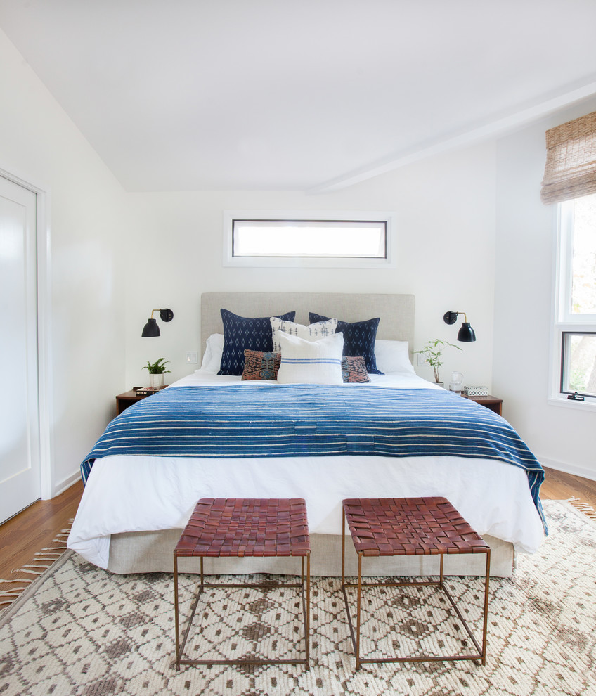 Example of an eclectic master bedroom design in Los Angeles with white walls