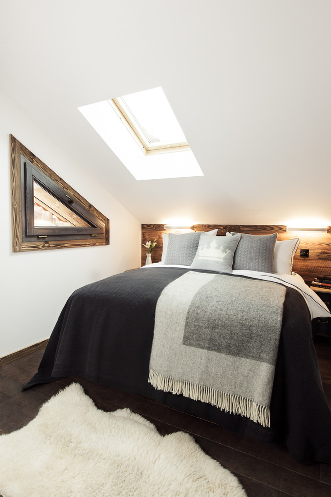Inspiration for a mid-sized rustic dark wood floor bedroom remodel in Lyon with white walls