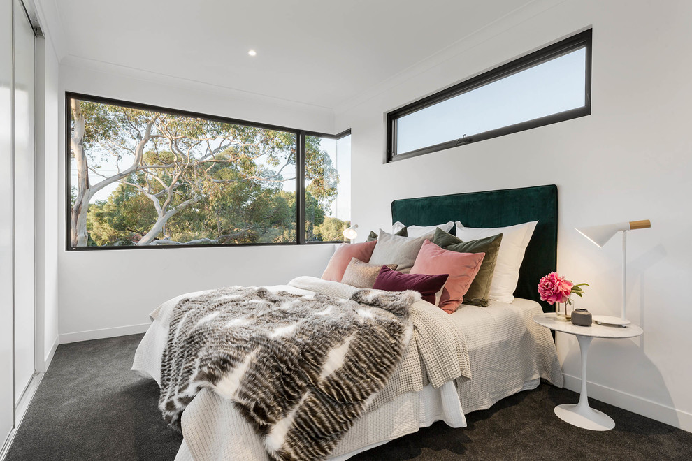 Inspiration for a scandinavian carpeted and gray floor bedroom remodel in Melbourne with white walls