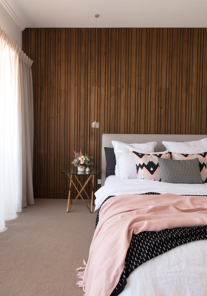 Inspiration for a contemporary carpeted bedroom remodel in Perth with beige walls